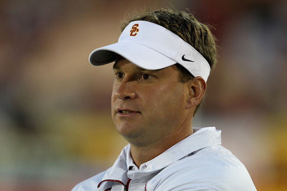 LOS ANGELES CA - SEPTEMBER 11:  Head coach Lane Kiffin watches the USC Trojans warm up for their game with the Virginia Cavaliers at Los Angeles Memorial Coliseum on September 11 2010 in Los Angeles California.  (Photo by Stephen Dunn/Getty Images)