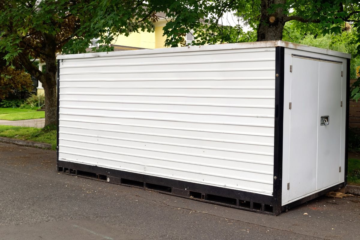 Moving container in the street in front of a home