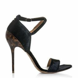 "<a href=""http://www.matchesfashion.com/product/161596"">Ponyskin and tortoiseshell high heel sandals by Maison Martin Margiela</a>, $318.40 (were $796)"