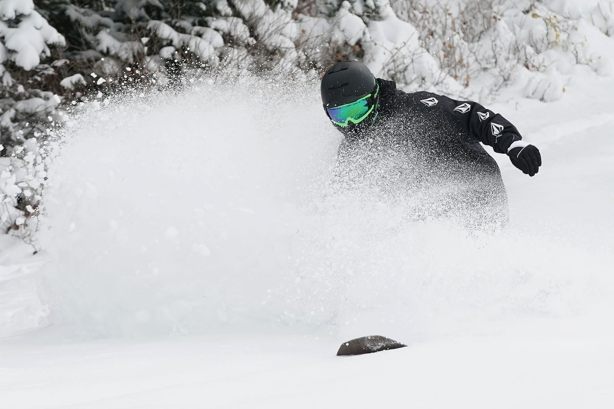 Toby Garner snowboards in the fresh snow at Alta Ski Area after hiking up the mountain on Tuesday, Oct. 12, 2021.