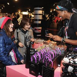 Fans browse the merchandise after midnight.