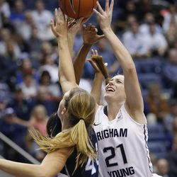 Brigham Young Cougars guard Lexi Eaton Rydalch (21) scores over San Diego Toreros forward Sydney Williams (44) in Provo Thursday, Feb. 18, 2016. BYU won 68-60 and won the West Coast Conference championship.