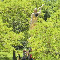 The lightning-damaged Angel Moroni statue is lowered from atop the Bountiful Utah Temple in Bountiful on Wednesday, June 1, 2016. Lightning struck the statue on May 22, 2016.
