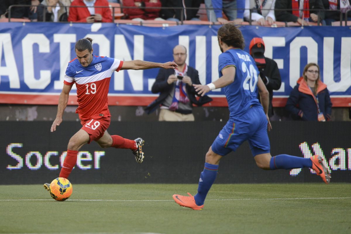 Graham Zusi prepares to send a cross of freedom off the foot of liberty
