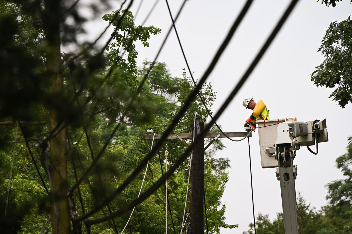 A Worker Fixes Downed Power Lines on Long Island Following Tropical Storm Isaias