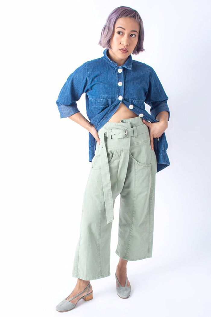 Model in green pants and blue shirt.