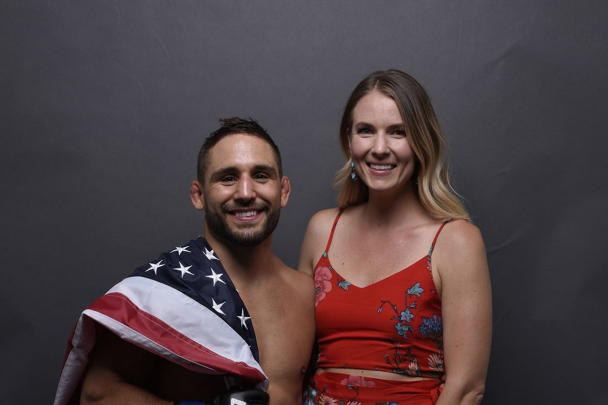 Chad Mendes poses with his wife after defeating Myles Jury in 2018.