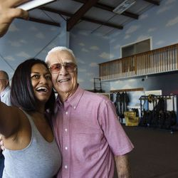 Danielle Garrick, left, and her grandfather, Wendell Ashcroft, take a selfie in the hangar of Skydive Ogden in Ogden on Saturday, Aug. 5, 2017. Garrick is Ashcroft's first grandchild and planned the skydiving adventure for her family.