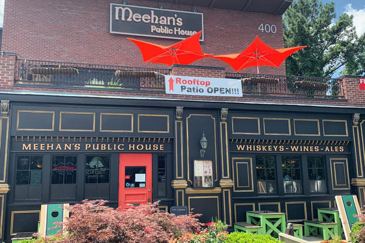 The exterior with rooftop patio and street side patio of Meehan's Irish Pub in Sandy Springs