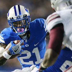 Brigham Young Cougars running back Jamaal Williams (21) looks for an opening as BYU and Mississippi State play in Provo at LaVell Edwards Stadium on Friday, Oct. 14, 2016.