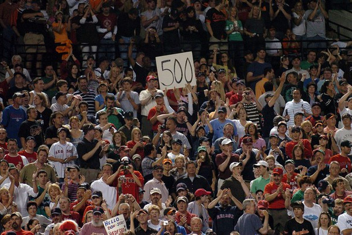Red Sox fans celebrate Manny Ramirez's 500th home run at Camden Yards in 2008.
