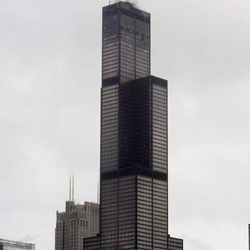 """FILE- In this March 12, 2009, file photo, the Sears Tower, then the tallest building in America at 1,451 feet, rises above Chicago. One World Trade Center, the giant monolith being built to replace the twin towers destroyed in the Sept. 11 attacks, will lay claim to the title of New York City's tallest skyscraper on Monday, April 30, 2012, as workers erect steel columns that will make its unfinished skeleton a little over 1,250 feet, just high enough to peak over the observation deck on the Empire State Building.  Workers are still adding floors to the so-called """"Freedom Tower"""" and it isn't expected to reach its full height for at least another year, at which point it is likely to be declared the tallest building in the U.S."""
