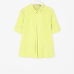 """Pleated front shirt, <a href=""""http://www.cosstores.com/us/Women/Sale/Pleated_front_shirt/16265326-15920370.1#c-15146012"""">$62</a>"""