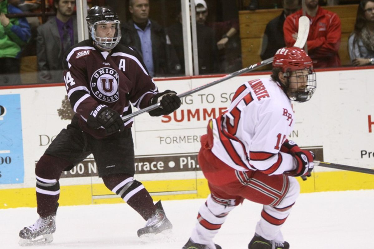 Shayne Gostisbehere, left, in action against RPI on Friday night at Messa Rink. The Dutchmen won 4-3 over their archrivals from Troy.