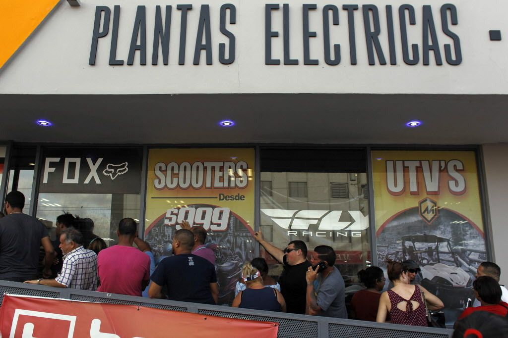 A line of customers waits for the arrival of generators at a power sports store as Hurricane Maria approaches in San Juan, Puerto Rico, on Sept. 18, 2017.   Ricardo Arduendo/AFP/Getty Images