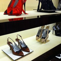 We managed to sneak one photo of a few pairs of shoes. The satin peep-toes at the top were seen in the top-secret runway show.
