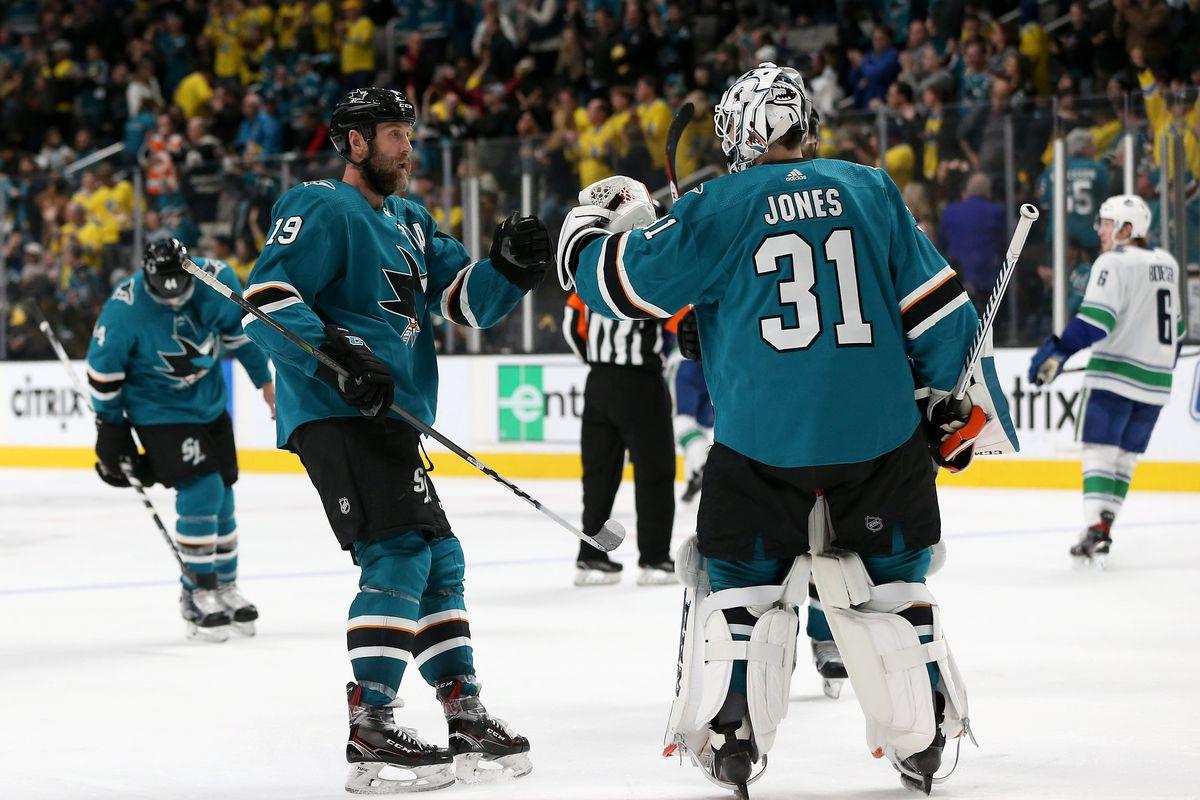 SAN JOSE, CALIFORNIA - FEBRUARY 16: Joe Thornton #19 of the San Jose Sharks congratulates Martin Jones #31 after they beat the Vancouver Canucks at SAP Center on February 16, 2019 in San Jose, California.