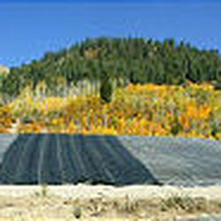 Tailings from gold and silver mines are covered by polyethylene fabric.