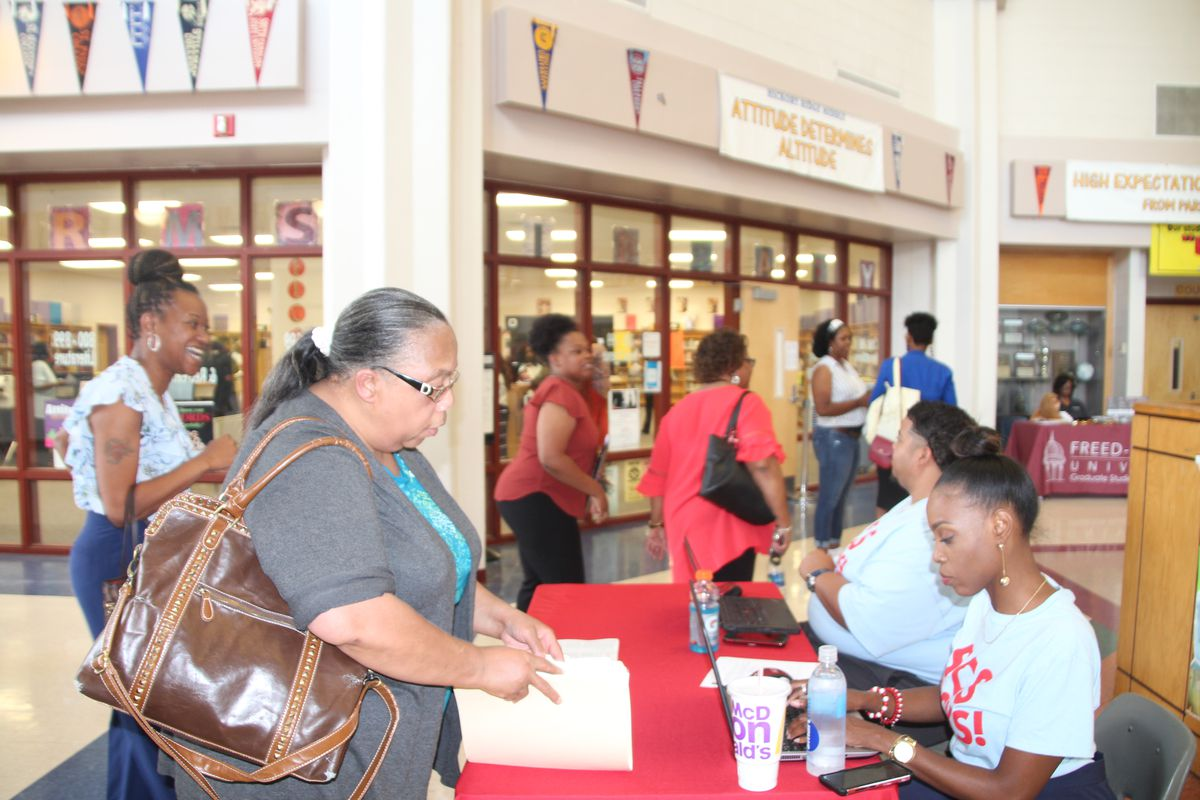 Semi-retired kindergarten teacher Sandra Jenkins checks in with district personnel at a Shelby County Schools job fair. July 11, 2019.