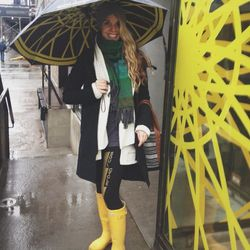 On the rainy and cold days I love to bust out my yellow <b>Hunter</b> rain boots. I call them my sunshine on a cloudy day! And of course, no rainy day is complete without my SoulCycle umbrella :)