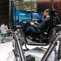 Dennis Kelly, of Iowa City, Iowa, tries out the Toyota Supra simulator Saturday at the 2020 Chicago Auto Show.