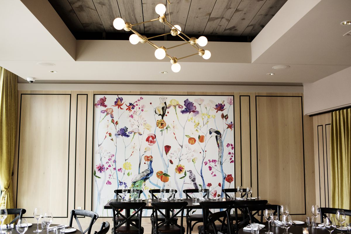 """The """"garden room"""" with floral wallpaper at Bellecour"""