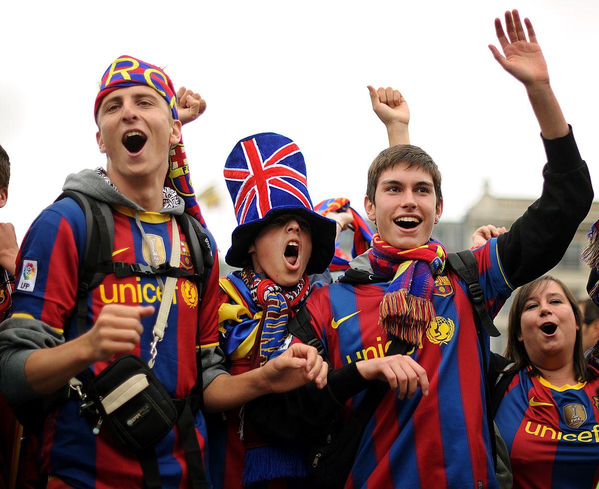 Barcelona football fans sing in Trafalga