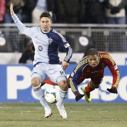 Real's Chris Schuler dives dives to the turf as he tries to get around Kansas City's Claudio Bieler as Real Salt Lake and Sporting KC play Saturday, Dec. 7, 2013 in MLS Cup action. Sporting KC won in a shootout.