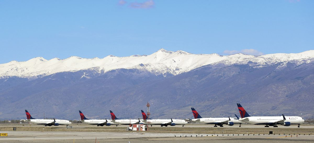 Delta Air Lines jets are parked at the Salt Lake City International Airport on Friday, April 10, 2020.
