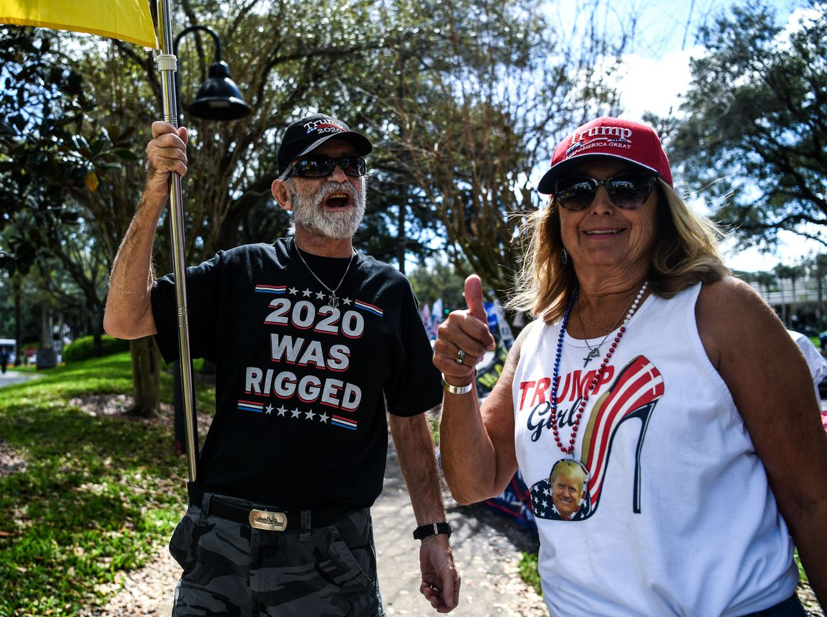 Supporters of former President Donald Trump wait for his arrival Sunday, Feb. 28, 2021 outside of a hotel where the Conservative Political Action Conference 2021 was being held in Orlando, Florida.