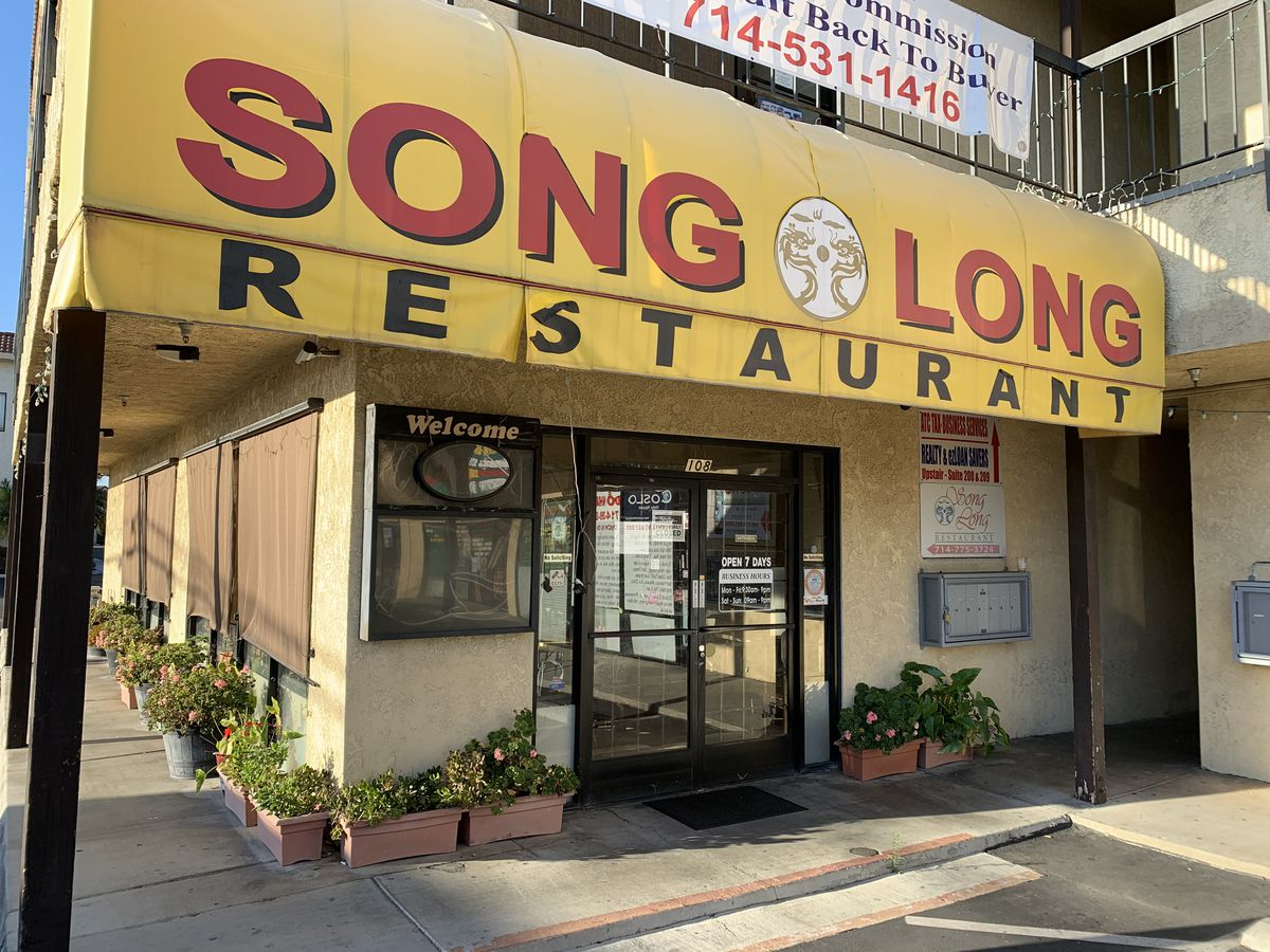 Song Long restaurant exterior with yellow awning in Westminster