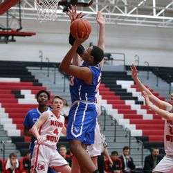 Crane's Robert Hobbs (23) scores against Maine South during their 60-40 loss in Park Ridge, Saturday, February 9 2019.   Kevin Tanaka/For the Sun Times
