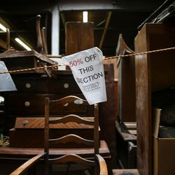 A sign marks a section of items on sale at Euro Treasures Antiques in Salt Lake City on Thursday, June 8, 2017.