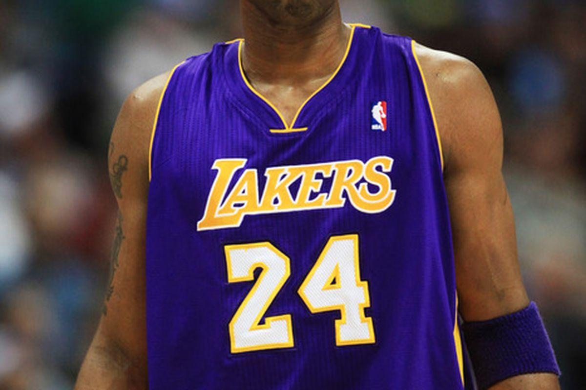 Kobe Bryant, likely holding something in ...
