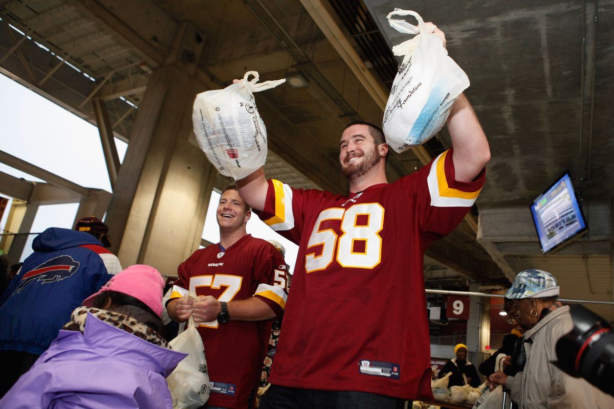 Thanksgiving Food Handing Out To Needy Families At FedEx Field