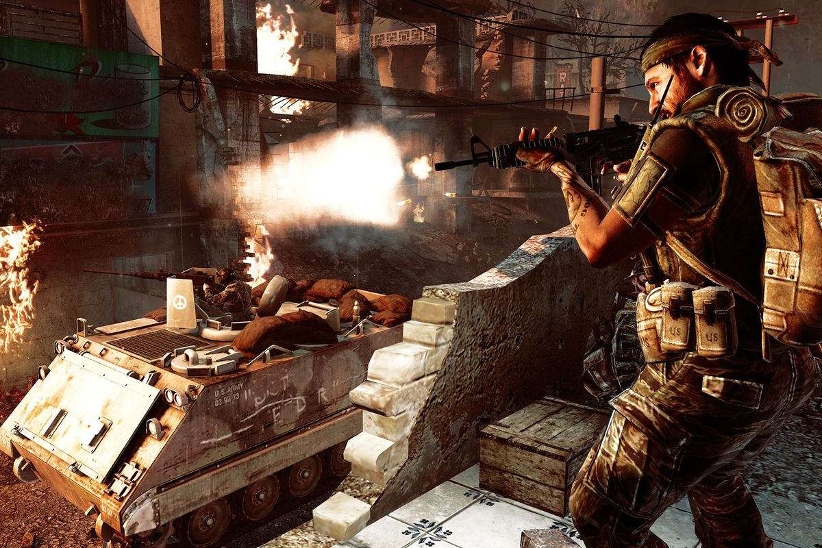 Call of Duty: Black Ops - soldier firing as tank gunner fires in the background