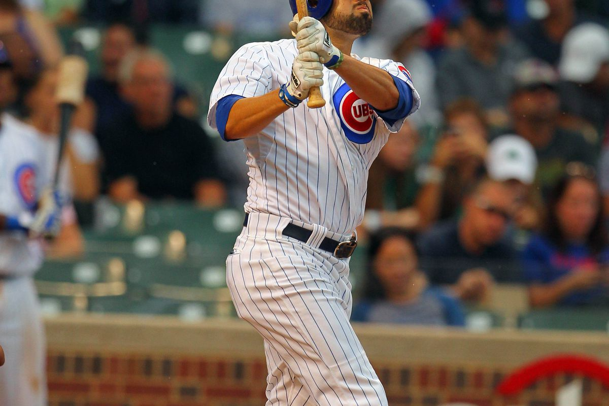 Sep 1, 2012; Chicago, IL, USA; Chicago Cubs right fielder David DeJesus (9) hits a 2 run home run during the third inning against the San Francisco Giants at Wrigley Field. Mandatory Credit: Dennis Wierzbicki-US PRESSWIRE
