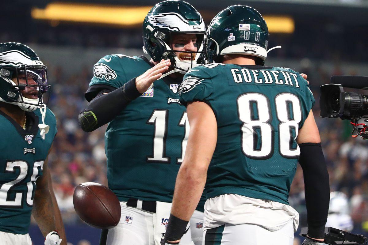Philadelphia Eagles quarterback Carson Wentz celebrates a first quarter touchdown with tight end Dallas Goedert against the Dallas Cowboys at AT&T Stadium.