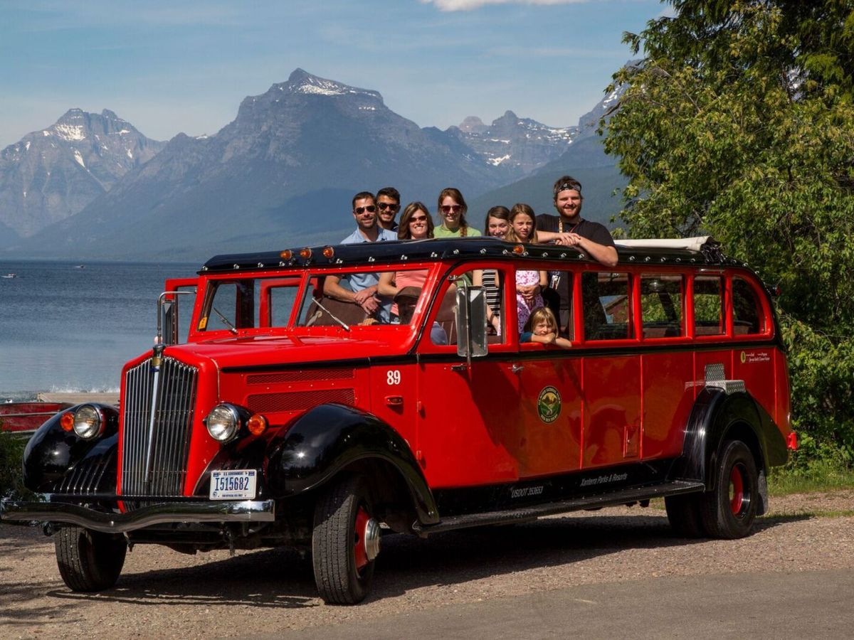 """And though the newer buses are automatics, back in the day the buses of the Glacier National Park Red Bus Tour had manual transmissions and the drivers oftentimes """"jammed"""" the gears to shift; those drivers became known as jammers. That nickname stuck, and"""