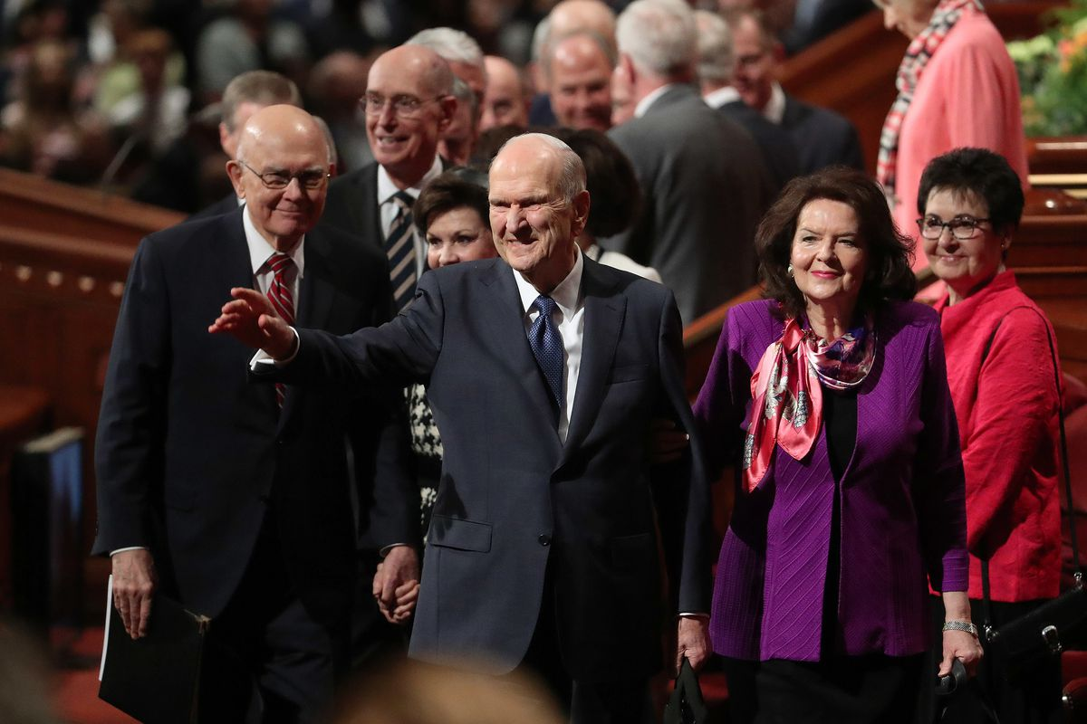 President Russell M. Nelson of The Church of Jesus Christ of Latter-day Saints, and his wife, Sister Wendy Nelson, wave to attendees after the Sunday morning session of the 189th Annual General Conference of The Church of Jesus Christ of Latter-day Saints