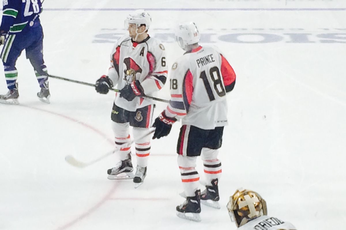 Chris Wideman and Shane Prince talk strategy during a recent game for the Binghamton Senators