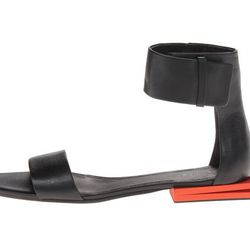 "<b>Calvin Klein</b> Urma Sandal, <a href=""http://www.farfetch.com/shopping/women/calvin-klein-urma-sandal-item-10702806.aspx?storeid=9226&ffref=lp_11_"">$695</a> at Edon Manor"