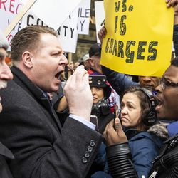 Former mayoral candidate and community activist Ja'Mal Green spars with Fraternal Order of Police supporters who protested against Cook County State's Attorney Kim Foxx outside the county administration building,  Monday, April 1, 2019. | Ashlee Rezin/Sun-Times