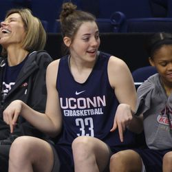 UConn's Chris Dailey laughs at something Katie Lou Samuelson (33) said.