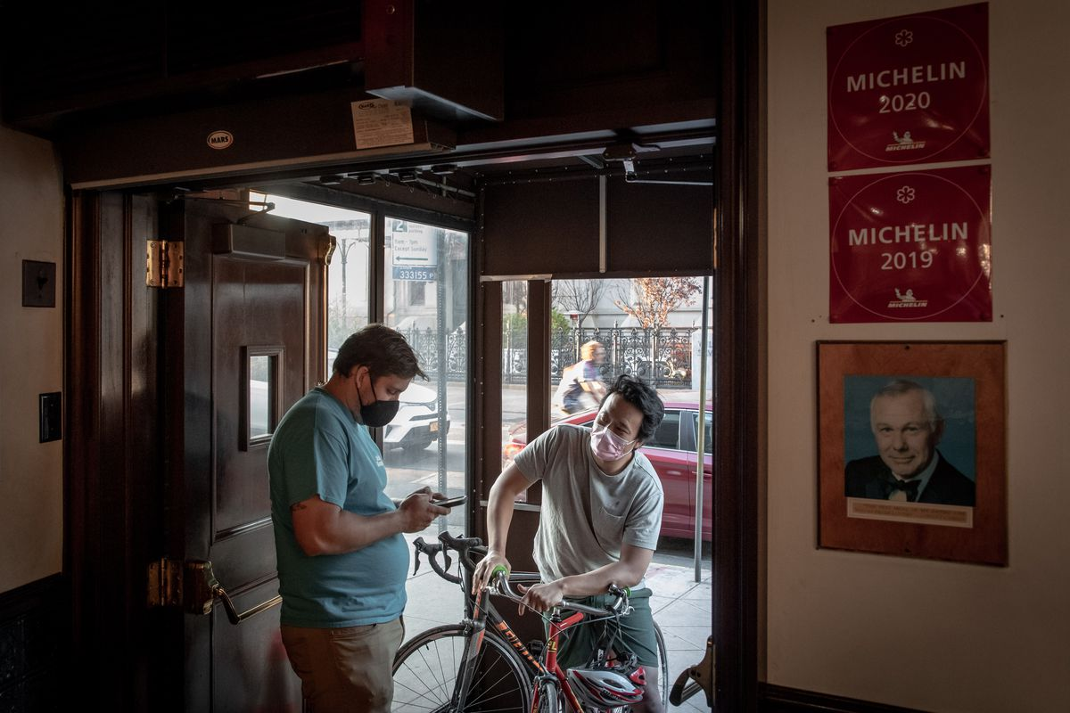 Trigg Brown and Richard Ho order takeout at Peter Luger