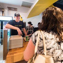 Chiko co-founder Scott Drewno working the register.