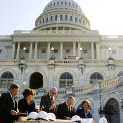Members of the Joint Congressional Committee on Inaugural Ceremonies, from left to right, Acting Architect of the Capitol Stephen T. Ayers, Sen. Dianne Feinstein, D-Calif, Sen. Bob Bennett, R-Utah, Senate Majority Leader Harry Reid, D-Nev., and House Speaker Nancy Pelosi, D-Calif., hammer the first nails for the presidential inaugural platform, Wednesday, Sept. 24, 2008, on Capitol Hill in Washington.