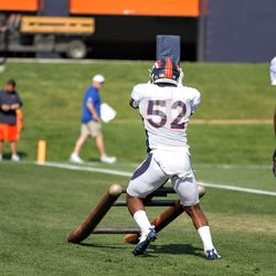 Broncos ILB Jerrol Garcia-Williams gets this smaller padded sled off the ground.