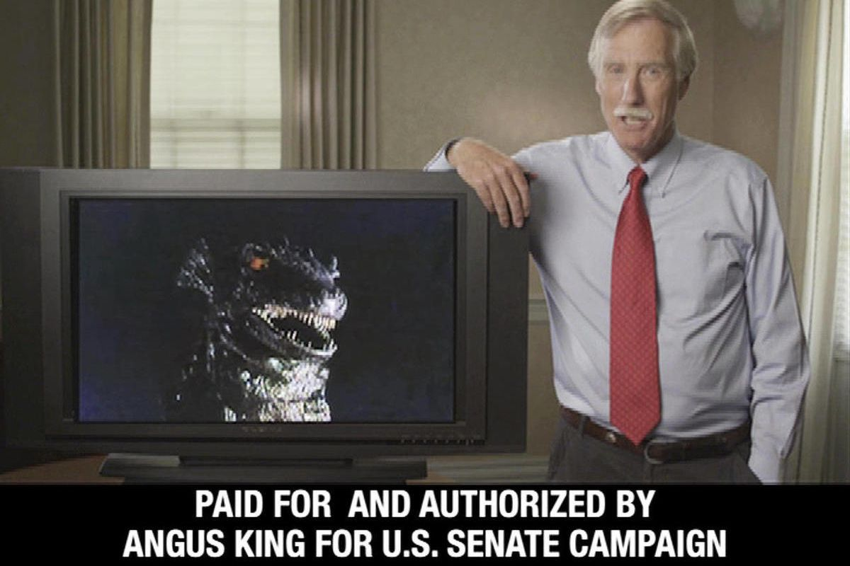 This still frame from a campaign video advertisement released by the Angus King for Senate campaign, shows King in Maine, with an image of Godzilla on a monitor. King, an independent and former governor, says his opponents are trying to portray him as a m