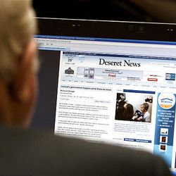 Representative Melvin R. Brown reads the Deseret News online prior to the start of the 2009 session of the Utah Legislature at the Capitol building in Salt Lake City, Monday.